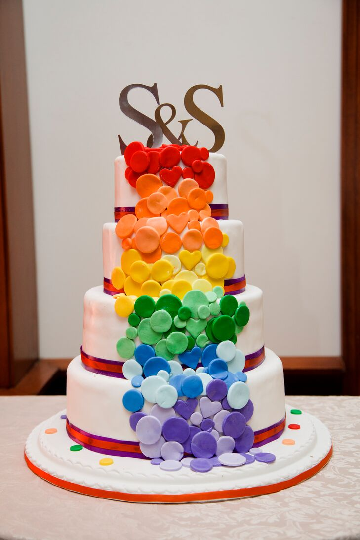 The couple's four tier cake had bright rainbow fondant circles cascading down the side.