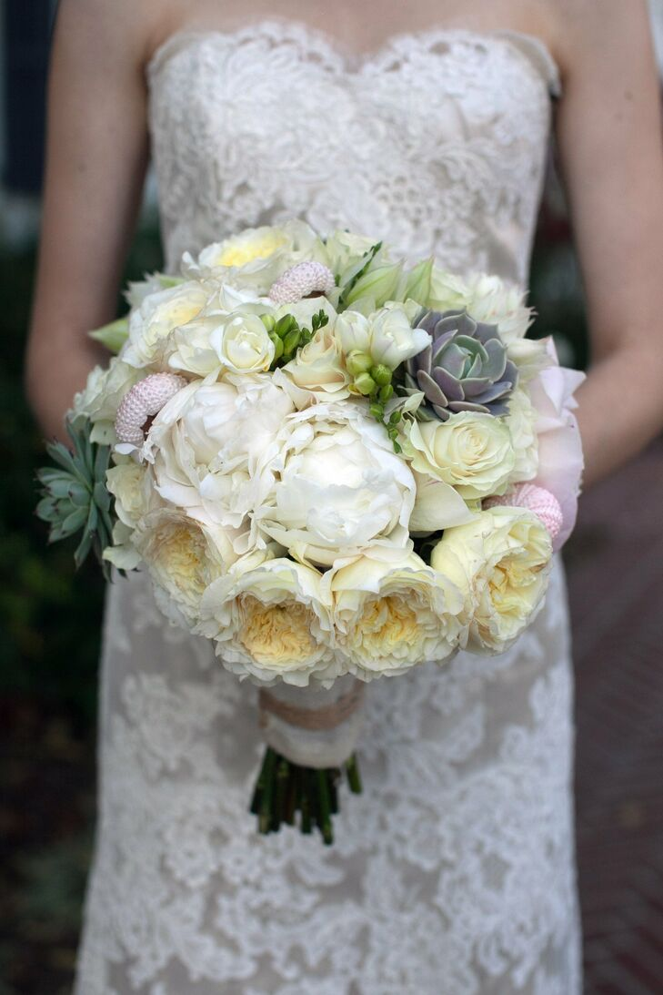 Large white garden roses and peonies complemented by succulents made up Jennifer's bridal bouquet.