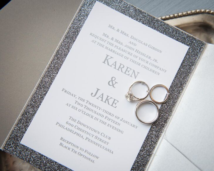 In keeping with the winter theme, Karen and Jake's wedding invitations were trimmed in sparkly silver and printed in a simple silver font on white cardstock. The glittery silver trim set the tone for an elegant, wintry wedding. The pretty invitation suite was created by designer Michael MacFerran.