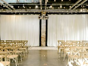 Industrial Loft Ceremony with White Draping, String Lights and Cross-Back Chairs
