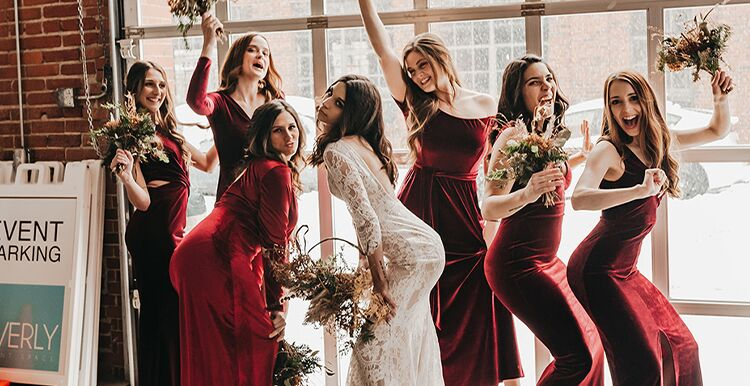 Bride and bridesmaids posing together