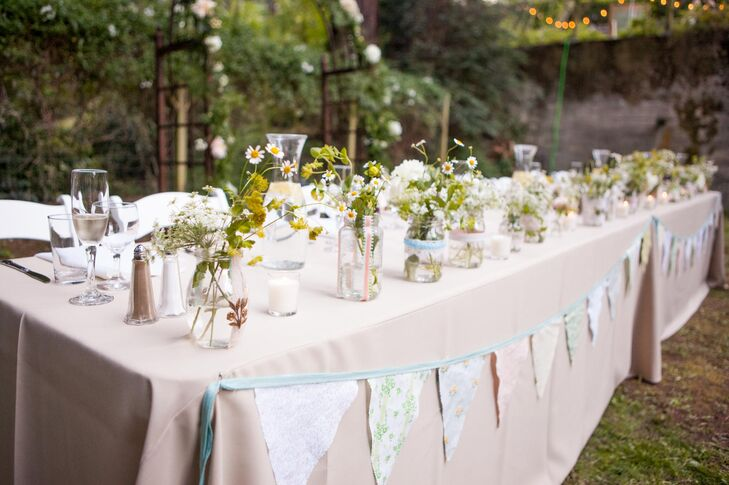 Ellen took on a number of DIY projects during the months leading up to the wedding. In addition to making all of the signs, favors and floral arrangements, Ellen cut and hand-stitched over 400 ft of bunting to decorate the reception tables. The effort was worth every second, because the result was stunning.