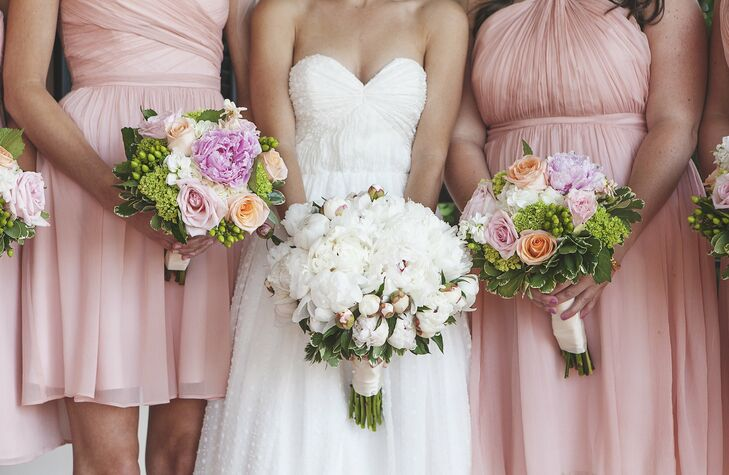 The bridesmaids had pink peonies, peach and cream garden roses, and green hydrangeas in their bouquets. Carter's bouquet was filled with her favorite flower: white peonies.