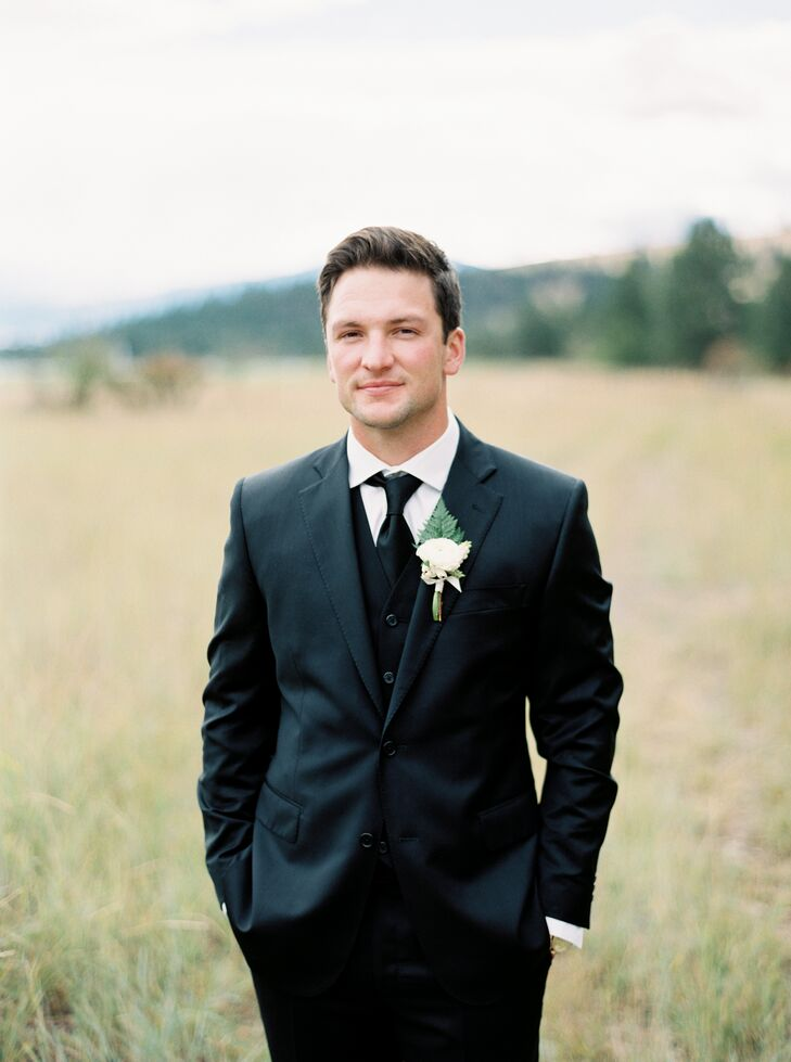 Brandon and his groomsmen wore traditional black suits, crisp white button-downs and black ties.