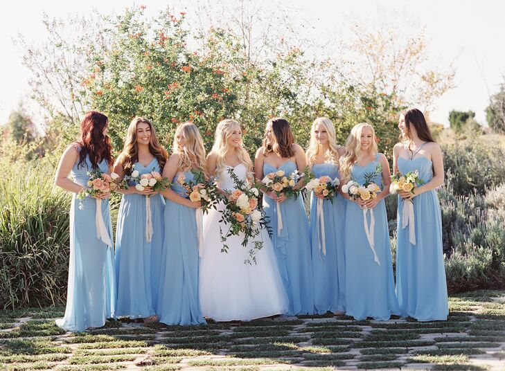 Brittany's bridesmaids donned powder blue gowns, which complemented their blue and ivory blossom bouquets.
