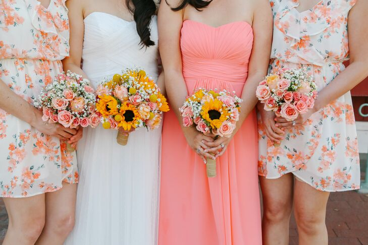 The bridesmaids held pink rose bouquets mixed with baby's breath that matched their coral dresses. The bridal bouquet also had pink roses and baby's breath, but had bright yellow sunflowers added to the assortment!