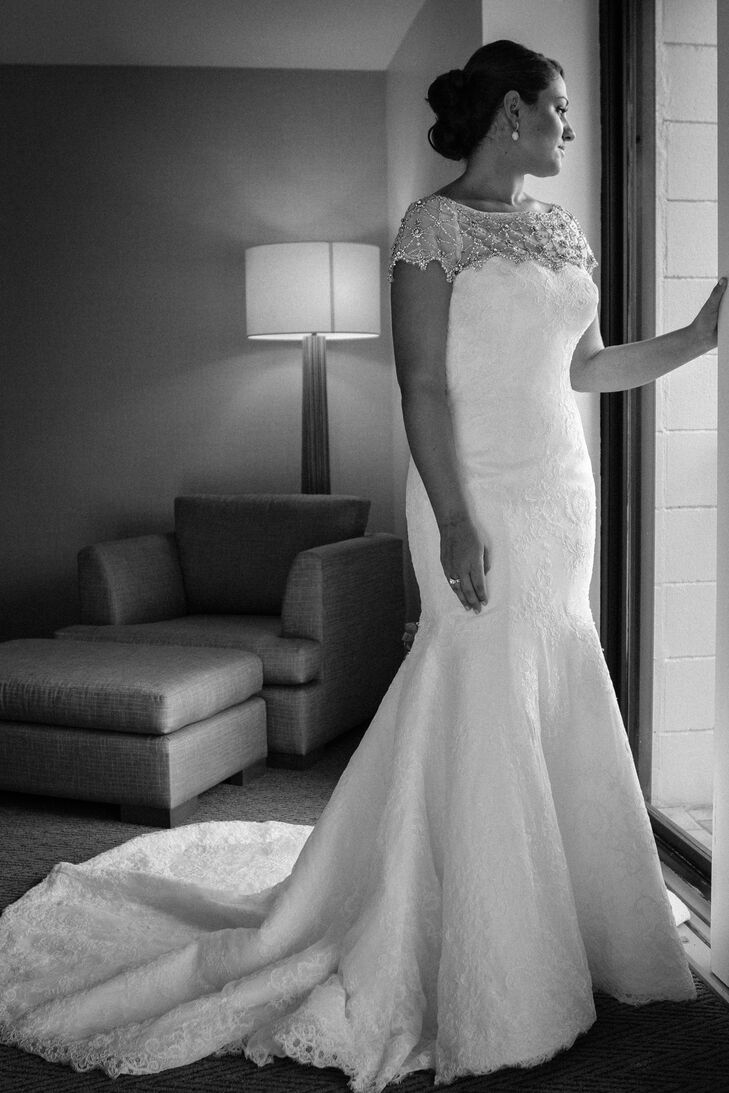 Dana wanted a modern dress with a vintage feel and ended up with a stunning Cristiano Lucci trumpet-fit gown with lace overlay. The illusion neckline and short sleeves were embellished with ornate beading. She paired the dress with gifts from her mother--diamond earrings and a cathedral-length veil.