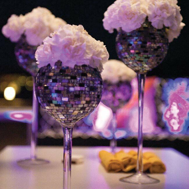 Small white carnations tucked into glittery goblets added a glam touch to the waterfront after-party.