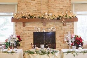 A Rustic Reception Fireplace with Wedding Banner