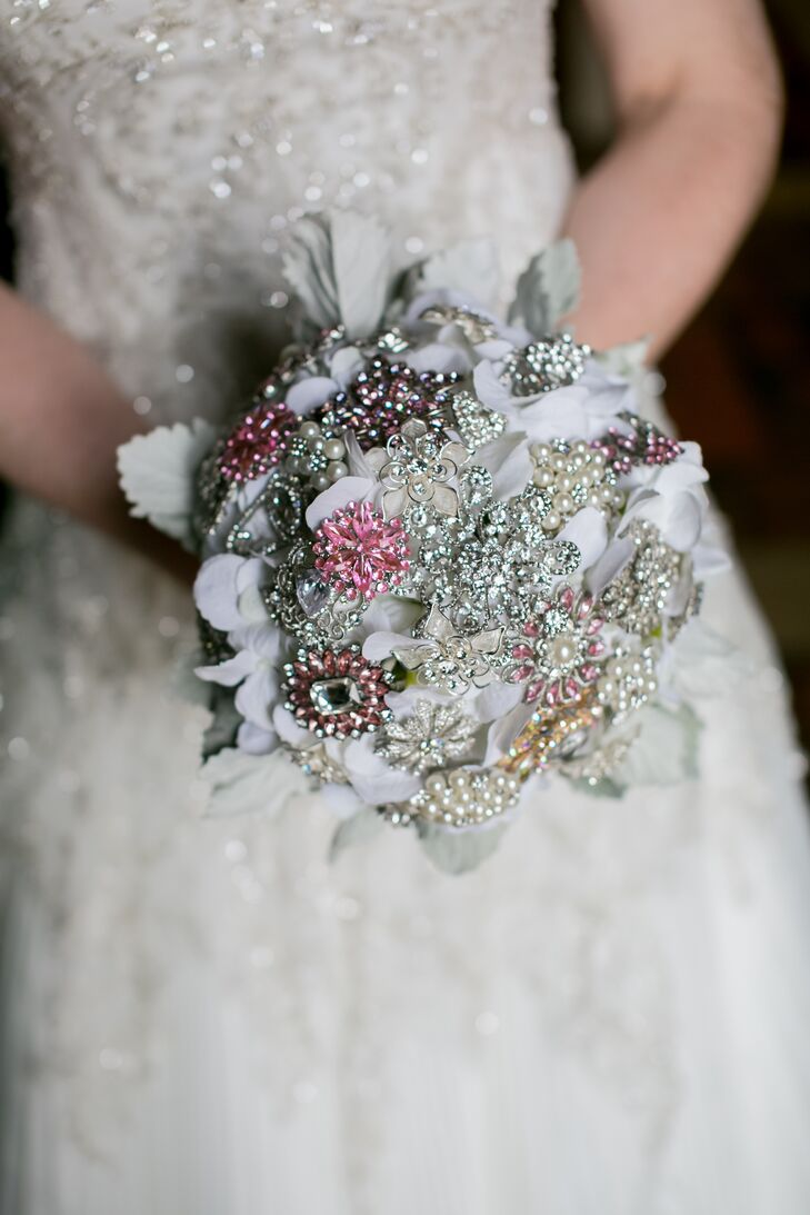 "The bride carried a brooch bouquet down the aisle. ""She really liked the idea of having a bouquet that wouldn't wilt,"" Nicholas says. It also fit the sparkly theme."