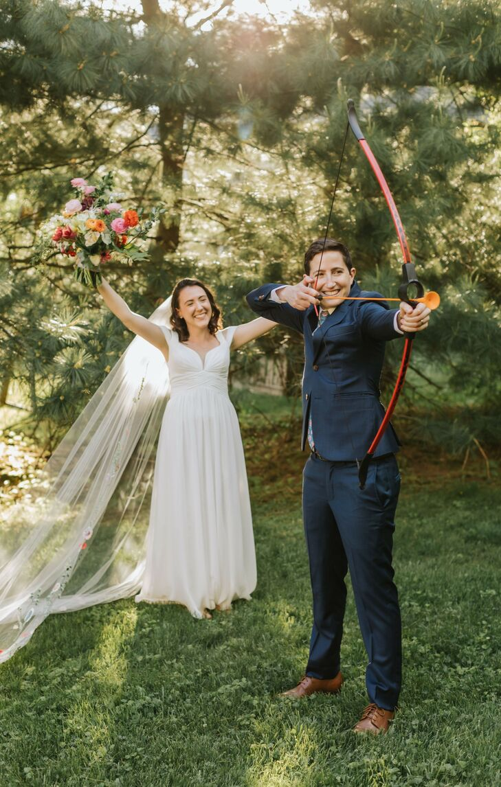 Couple Doing Archery During Camp-Inspired Backyard Wedding