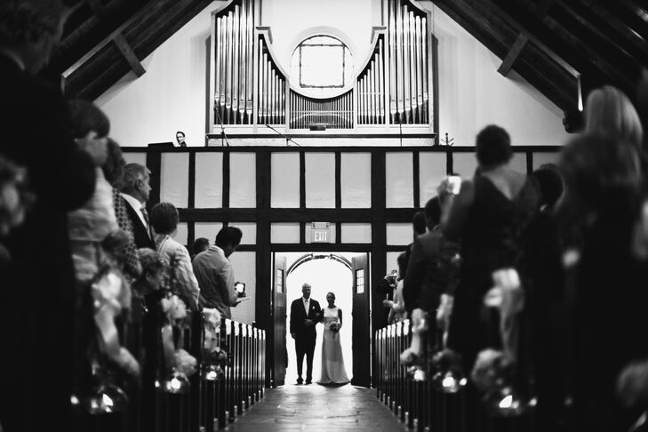 """""""Immediately after getting engaged, Mike and I knew that we wanted to get married at St. Brigid and host our reception on my grandparents' farm in Far Hills, New Jersey,"""" Cam says. Her family regularly attends church at St. Brigid, making it a sweet and personal place to say """"I do."""" She walked in with her uncle to """"Celebrate Me Home"""" by Kenny Loggins, a song she and her father used to dance to. White hydrangeas and white bows marked every aisle alongside hanging glass votives."""