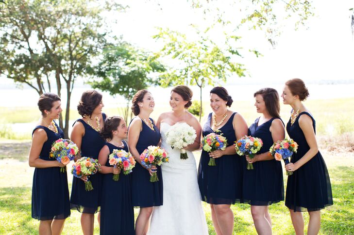 """One of my favorite elements ended up being our bridesmaid bouquets,"" says Jessica. ""With a very basic color palette for attire, I knew I wanted something bright for their bouquets, and our florist did a phenomenal job with bringing this vision to life!"""