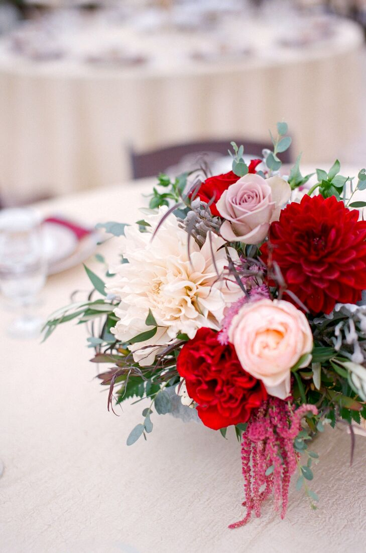 Warm elegance pervaded at the reception, merlot and pale pink garden roses were grouped with soft greenery and overflowed from midheight golden candelabras on each dining table.