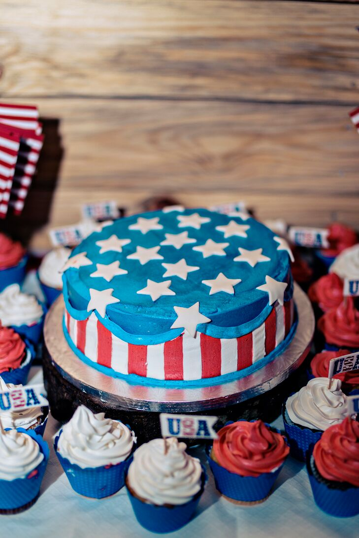 In line with the patriotic theme, Chris went for an American-flag-inspired groom's cake. Red, white and blue cupcakes surrounded the single-tier confection.