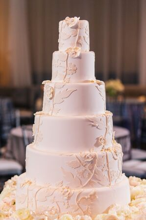 Ivory Wedding Cake With Floral Cutouts
