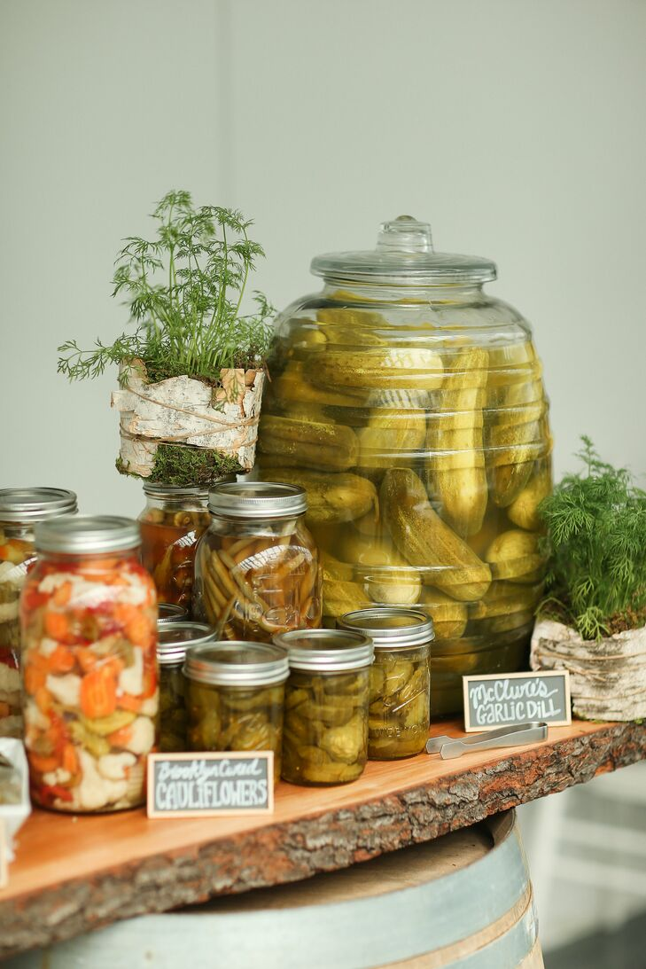 """One of my favorite parts of the wedding was a special request that I made based on my favorite food: a pickle bar,"" Lauren says. ""It included seven varieties of pickles, which our caterer placed in various jars and barrels. We used mini chalkboards to write where each of the pickles were from—all local Brooklyn vendors. We decorated it with dill plants inside birch holders."