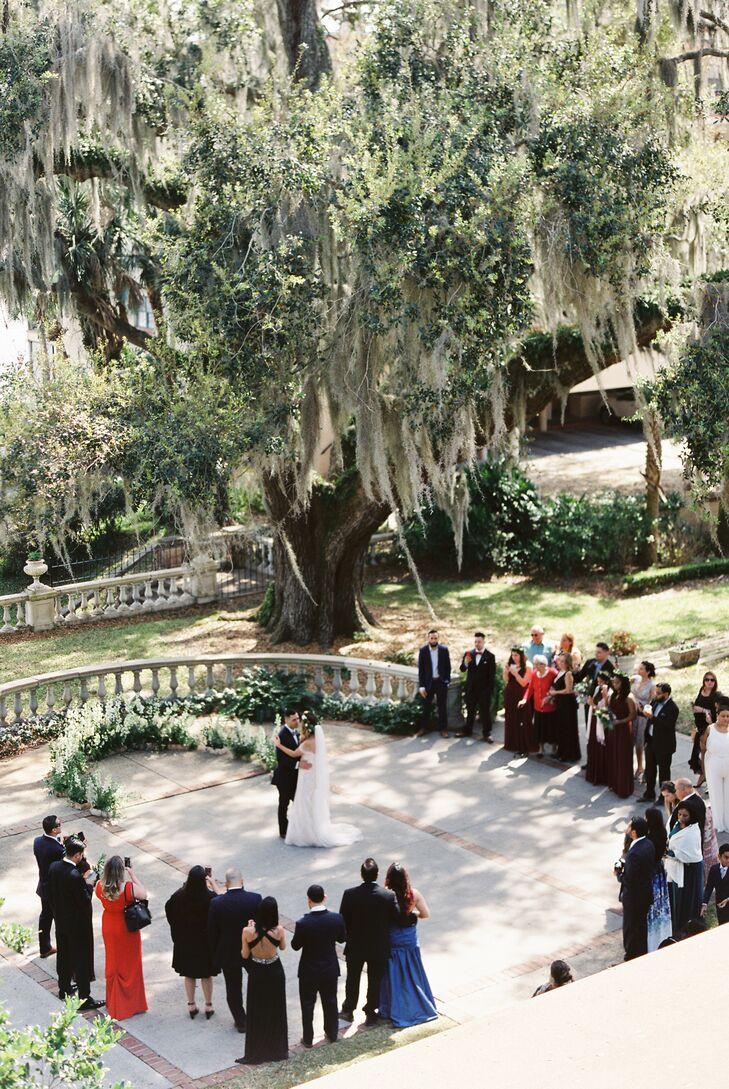 "Tammie and Yuri's first dance took place where they said their vows. ""Our first-dance song was to 'Like I'm Gonna Lose You' by Meghan Trainor. We danced outside under the old oak trees with our loved ones surrounding us,"" Tammie says. ""It was so meaningful and magical."""
