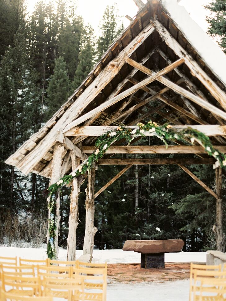 The ceremony took place in a snowy meadow. The pair said their vows under a rustic, wooden arbor with simple, mountain greens to adorn it.