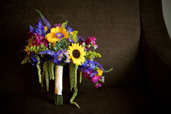 Chelcie carried yellow sunflowers, yellow ranunculus, green hanging amaranthus, green succulents, purple veronica and plenty of wildflowers in her lush bouquet. She loved how all the day's flowers were native to Kansas and suited the KSU Gardens ceremony site in Manhattan, Kansas.
