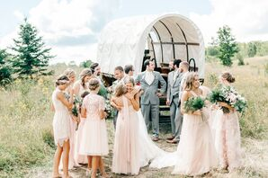 Wedding Party Riding Covered Wagon after Ceremony