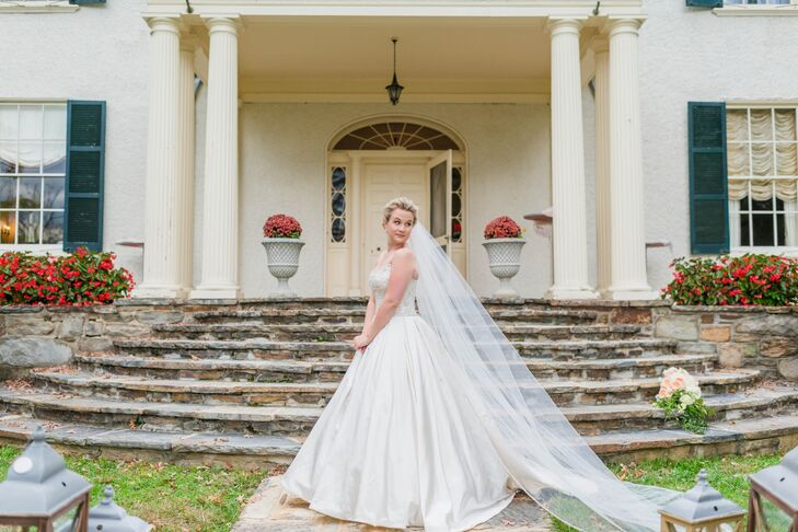 Katie's Alita Graham ball gown had a large chiffon skirt and crystal beading details. She paired the vintage inspired gown with a cathedral-length veil.