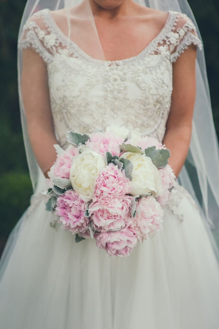 As Ashley's favorite flowers, peonies played a big role in all the floral arrangements and bouquets. Other flowers included roses, hydrangeas, snapdragons and dusty miller.