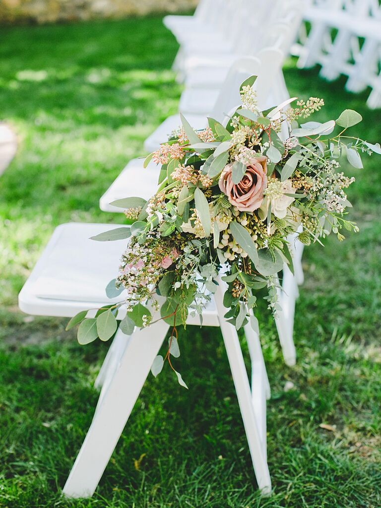 Rustic wedding ceremony aisle flower arrangement