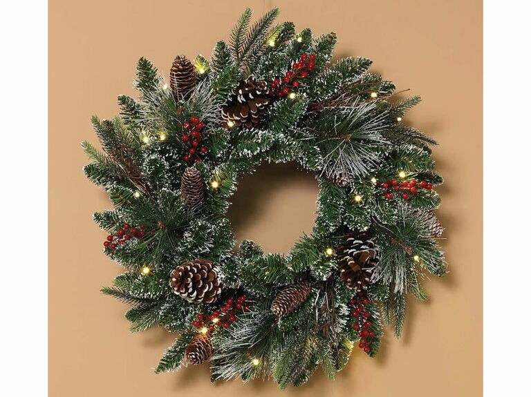 Frosted wreath with pinecones, berries and lights