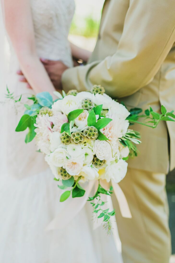 Napa's SoulFlower crafted a polished bridal bouquet for Emily made with blush garden roses, peonies, scabiosa pods, balsa wood flowers, white and green hydrangeas, eucalyptus and bay leaf garlands.