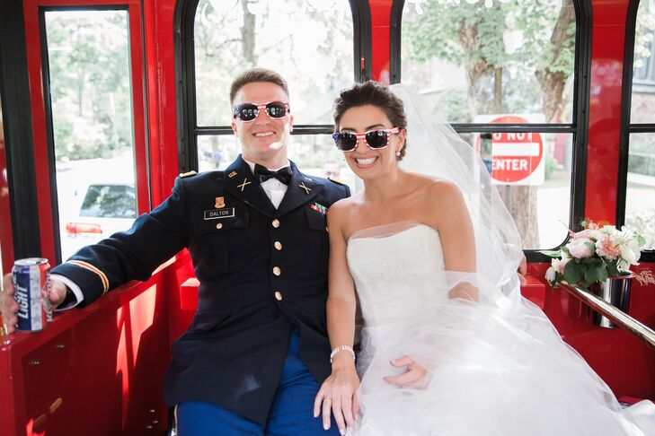 After exchanging vows at Our Lady of Perpetual Help, the newlyweds and their wedding party hopped aboard old-school trolleys, which shuttled them to the Hamilton Farm Golf Course in Gladstone, New Jersey, for the reception. Keeping with the subtle Fourth of July theme, the couple and their wedding party popped on American-flag-printed shades.
