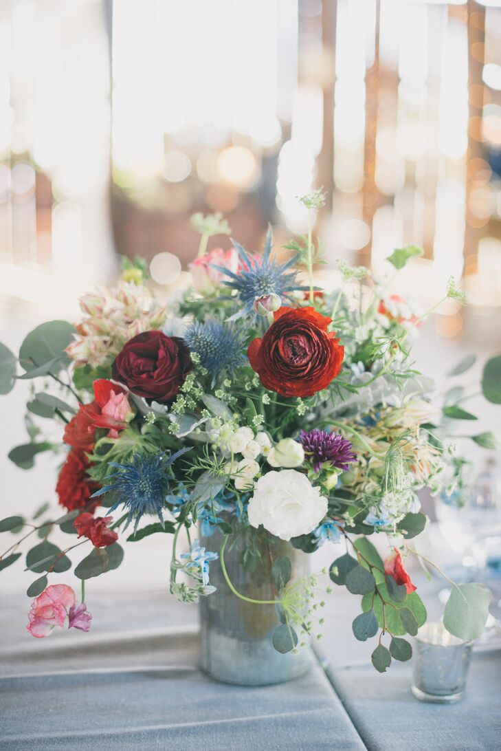 The eclectic, textured wildflower arrangements that included blue thistle, berries, geranium leaves, lisianthus, darcy roses, dahlias, Queen Anne's lace, tweedia, eucalyptus pods and anemone.