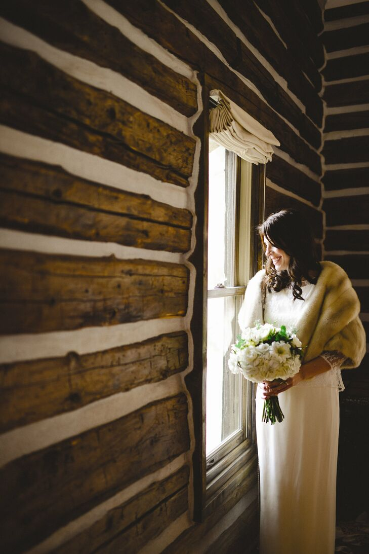 A fur stole added a vintage touch to Karine's bridal look.