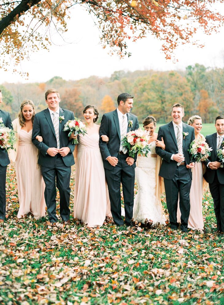 The bridesmaids dressed in floor-length, pale blush dresses, which were purchased and fitted from a seamstress on Etsy. The groomsmen donned gray suits with gray and champagne striped ties.