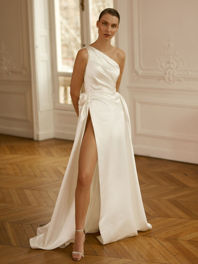 Dana Harel Spring 2020 Bridal Collection asymmetrical one-shoulder wedding dress with high leg slit