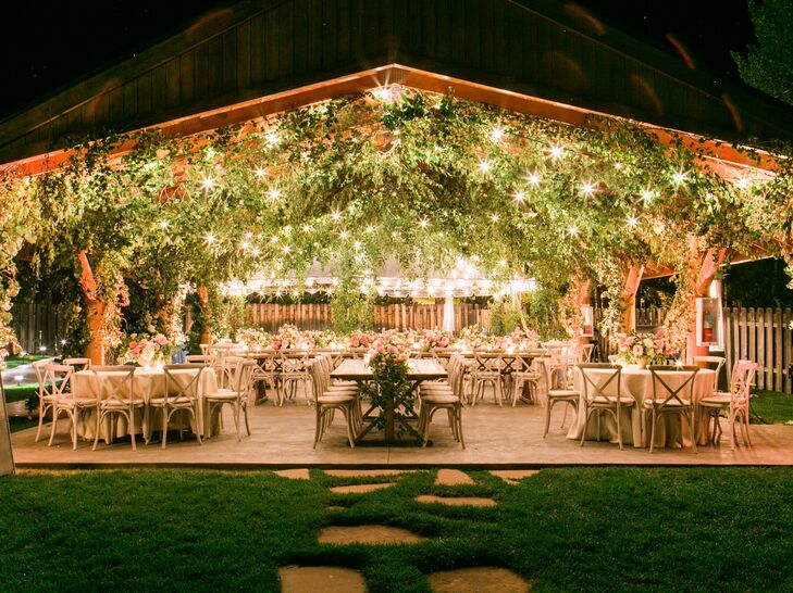 Reception Space Lined with Hanging Flowers, Greenery and String Lights