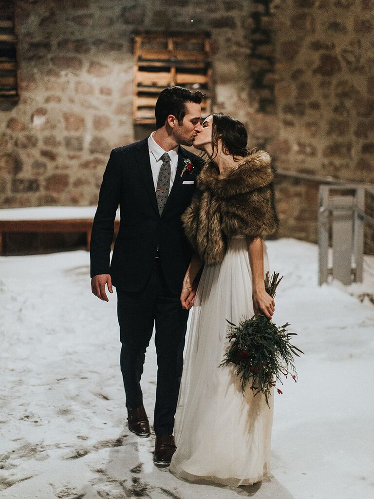 Brown fur wrap for a winter wedding