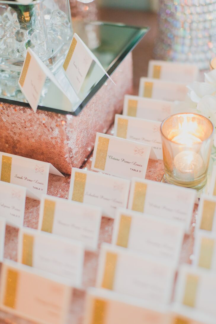 While Christina designed the wedding invitations herself, including the couple's monogram that graced each stationery element, the couple's event planner, Candy Buffet Company, created the escort cards for the reception. They listed the names and seating assignments of each guest in pink script font and featured a shimmery gold border and the couple's knot monogram.