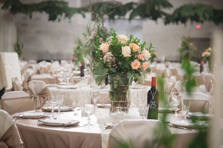Each of the 35 tables had different centerpiece arrangements. 10 of the tables had large peach and ivory garden rose centerpieces.