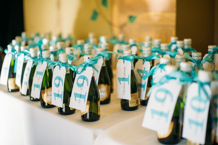 The escort cards were tied with Tiffany blue ribbon to mini champagne bottles, which also served as the guests' favors.
