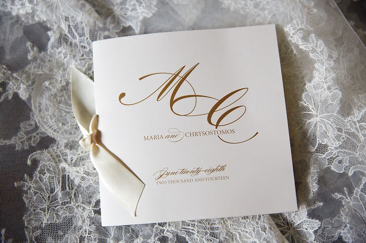 To match the classically elegant look of their wedding, Maria and Chris's ceremony programs were ivory stationery with chic gold typography. The program booklets were tied with satin ribbons for a little added romance.