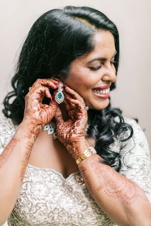 Bride Putting on Earrings for Indian Wedding in Concord, New Hampshire