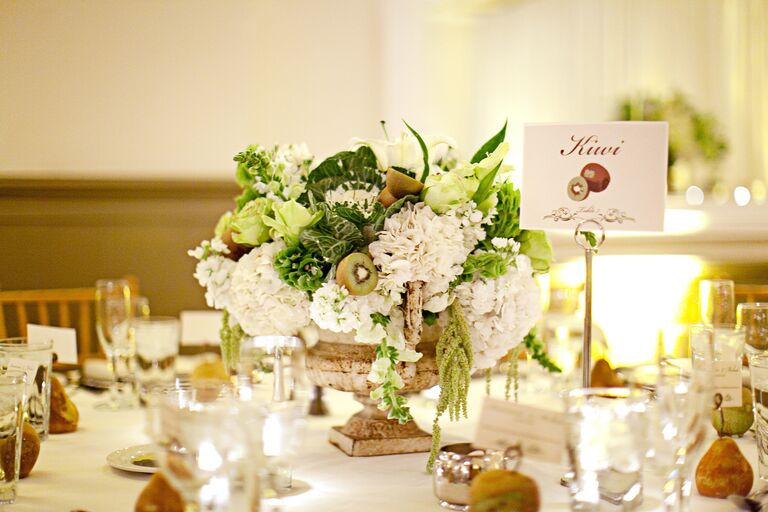 White and green kiwi centerpiece and table name card