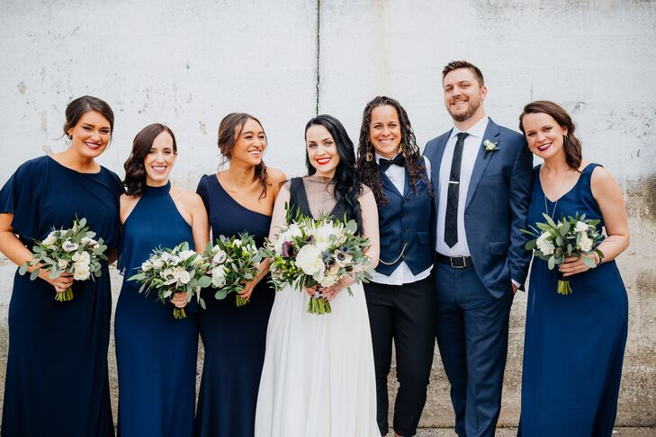 Wedding Party Wearing Blue Dresses and Suiting
