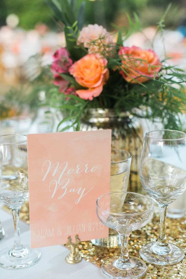 """We had watercolor coral table cards and named each table after local surf spots,"" Jillian says. These table cards' colorful watercolor motif was similar to that used on the invitations and RSVPs."