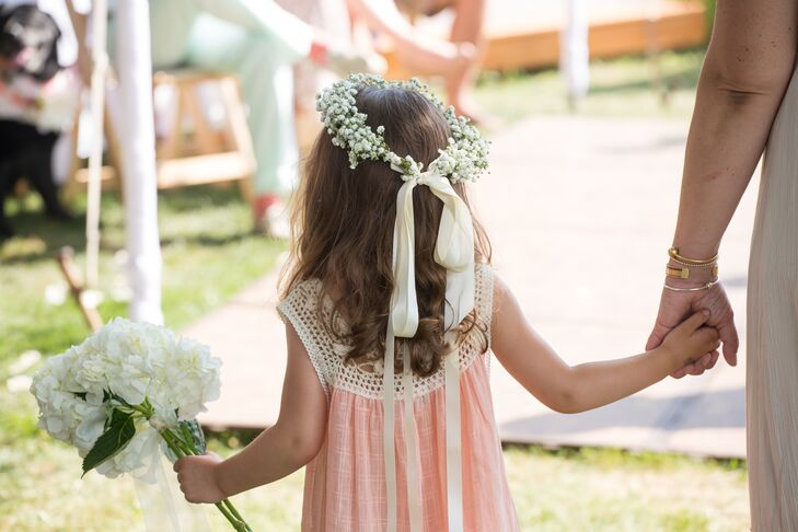 """The couple was sure to keep friends and family in mind when planning their relaxed summer nuptials. """"Good food, music, and drinks were at the top of our priority list,"""" the bride says."""