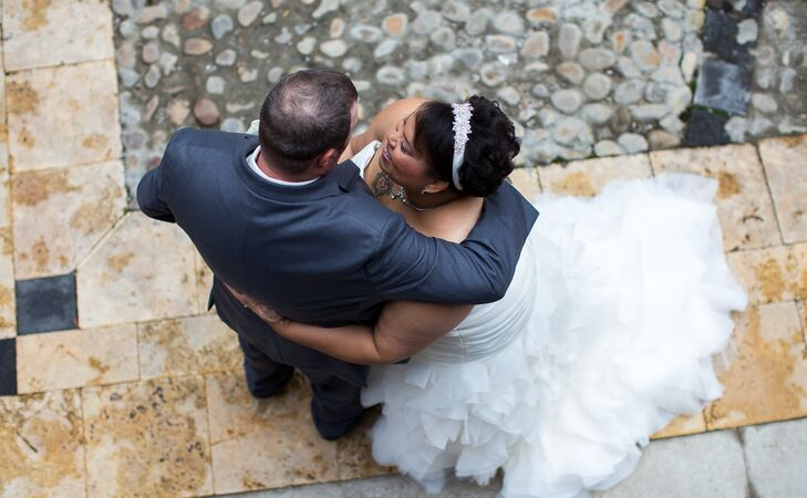 Veronica and John embraced each other near the cobblestoned road at Williamsburg Winery.