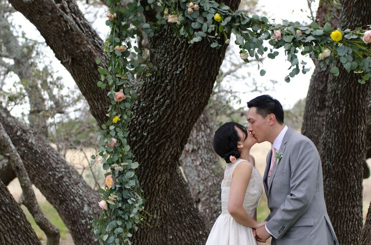 A beautiful, intricate grove of oak trees made the focal point for the ceremony. Minh and Miguel created a 40-foot long garland arbor made mostly with eucalyptus, which reminded the bride of her days living in San Francisco. Garden roses, ranunculus, rice flower and spray roses were added to give the garland little pops of color.