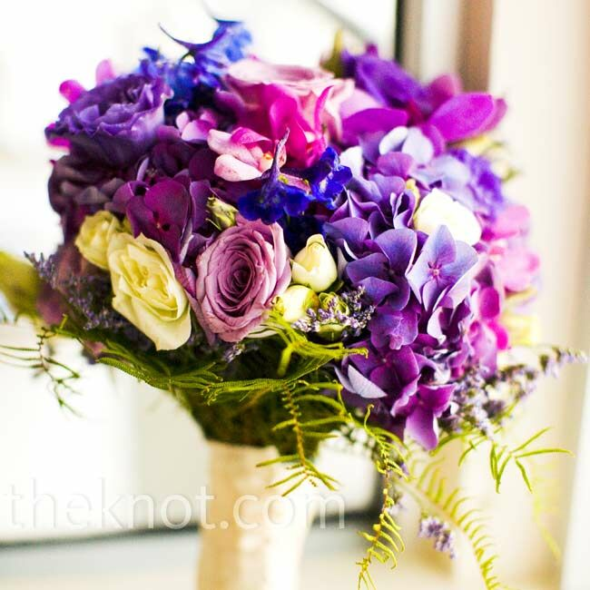 "Nicole's bouquet was a purple-lover's dream -- literally. ""It was exactly what I had envisioned,"" says the bride. The textural mix included hydrangeas, orchids, lisianthus, roses, and lavender."
