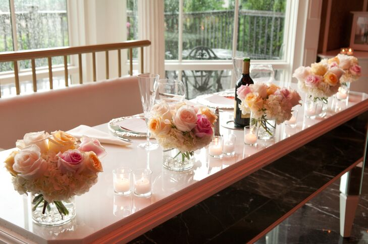 Small arrangements of blush roses and white hydrangeas decorated the tables at the reception.